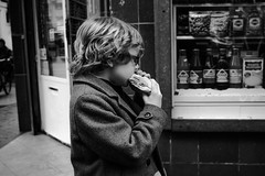 eating the sandwich (livio.luca) Tags: amsterdam street streetphotography blackandwhite bw kid eating netherlands holland