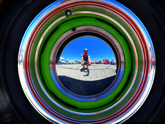 Shiny Places (splinx1) Tags: hubcap carshow hdr canonart canon powershot elph 330hs canonpowershotelph330hs reflection convex mirrored selfportrait handheld photomatixpro hss reflectomania california usflag concentric