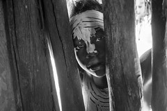 Behind the wood (Paolo Cinque / www.paolocinque.it) Tags: child blackandwhite monochrome bw portrait retrato ritratto people children awesome beautiful nice cool stunning perfect masterpiece composition terrific fantastic nikon nikkor reflex camera dx dslr lens photo photography photographer reporter reportage pic picture image shot travel traveller traveler travelling traveling visit visiting sight sightseeing tour tourist tourism world worldwide adventure discover discovery place tribe tribes poor kolcho karo omo omovalley ethiopian african ethiopia africa ancient culture eyes wood wooden village