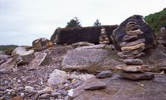 Stone Towers. [Nikon F5 Film] (Aviator195) Tags: nikon nikonfilm nikonf5 f5 film filmphotography filmisnotdead filmphotos filmscan filmphoto epson epsonv550 epsonperfectionv550 flatbed 35mm 35mmfilm fuji fujifilm fujichrome provia 100f provia100f slidefilm colourpositivefilm slide postive transparency transparencyfilm color colour colorful colourful sydney australia rock rocks rocky water wet stones stone avalon avalonbeach avalonheadland northernbeaches northern beaches beach beachscape pittwater