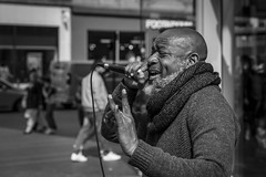 Life Is But A Song (Leanne Boulton) Tags: monochrome people musician urban street candid portrait portraiture streetphotography candidstreetphotography candidportrait streetportrait streetlife man male face facial expression emotion feeling mood singer singing busker performer music microphone tone texture detail depthoffield bokeh naturallight sunlight outdoor light shade shadow city scene human life living humanity society culture canon canon5d 5dmarkiii 70mm character ef2470mmf28liiusm black white blackwhite bw mono blackandwhite glasgow scotland uk