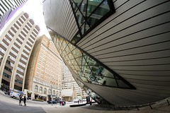 Looming (Karen_Chappell) Tags: fisheye rom museum travel toronto architecture wideangle city urban building buildings canonef815mmf4lfisheyeusm windows glass abstract geometry geometric curves royalontariomuseum