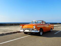 Orange Classic Car in Havana, Cuba, Driving on the Malecon (shaire productions) Tags: cars image picture photo photograph vehicles automotive automobile classic vintage style stylish cuba cuban havana travel imagery photography wheels blue road streets urban cruisin malecon fast furious orange cruising boulevard street scene city lowrider driving world traveler