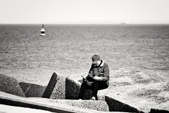 A quiet place to read a book. (wimkappers) Tags: blackwhitephotos bw monochrome book reading people sea pier