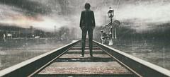 Untitled (Cammino & Vivo Capovolto ☆ Claudio ☆) Tags: retrospect treno pioggia atmosfera binari rails tracks shadow luci lights lampioni rain
