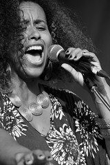 Flavia Sings (pkellypics) Tags: digital bw canon 6d kitchener ontario canada northamerica music musician singer singing mike microphone festival kultrunfestival 2016 victoriapark flavianacimento woman necklace