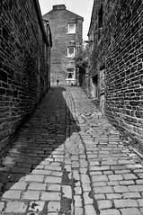 Where Emily Once Trod (Richie Rue) Tags: nikond300 mono monochrome blackandwhite bronte brontes cobbles cobbled street narrow northern town stone terraced walls emily charlotte anne thornton bradford yorkshire