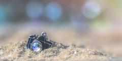 beach memories (rockinmonique) Tags: miniature camera charm sand beach light bokeh blue gold summer sparkle atthebeach moniquew canon canont6s tamron copyright2017moniquew