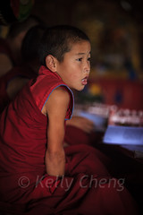Mongolia-130803-637 (Kelly Cheng) Tags: amarbayasgalantmonastery asia buddhism centralasia mongolia boy ceremony child color colorful colour colourful culture heritage indoor monk people persons pray prayer red religion tourism travel traveldestinations vertical vivid