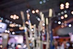 Car show bokeh! (ineedathis,The older I get the more fun I have....) Tags: internationalautoshow blur bokeh jacobjavitscenter autoshow cars lights nyc manhattan newyork vehicles autos nikond750