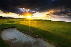 In to the Sun (Chris Lishman) Tags: bamburgh bamburghcastlegolfclub sunset sun flare northumberland sunny warmth sea coast coastal