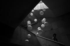 (cherco) Tags: woman stairs escaleras ball lamp lampara down colgante museum city urban geometry light luz shadow blackandwhite blancoynegro g5x canon alone lonely silhouette silueta