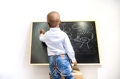 A black little boy in class (Madridstock) Tags: learning male school studying class education boy child black blackboard board cage student writing write view caucasian art chalkboard lil little painting shirt kid jeans standing concept drawing study chalk reading day desk development elementary cute closeup bald book childhood classroom front happy pencil shoulders sitting literacy learn head