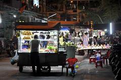 Food and souvenirs (Roving I) Tags: streetmarkets nightmarkets nightlife plasticchairs breadrolls vendors food souvenirs tourism hoian vietnam
