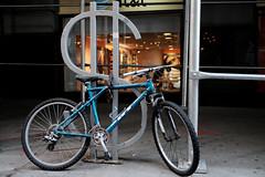 Wall Street GT Bicycle (Zach K) Tags: wallstreet wall street nyc lower manhattan financial district bikerack bike rack aqua blue bicycle gtbike gt locked up front att store new york city nycbike nybike citybike velo two wheeler fujfilm xt1 fuj money
