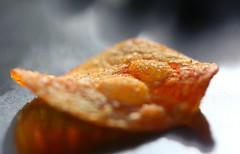 sunbaking chip - 1 (HansHolt) Tags: chip potato paprika bellpepper taste bubbles bobbels sunbaking sun backlight backlit tegenlicht reflection reflectie weerspiegeling macro bokeh dof canon 6d 100mm canoneos6d canonef100mmf28macrousm macromondays chips hmm