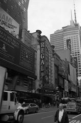 A Regal Affair (Alex Luyckx) Tags: newyorkcity newyork nyc usa manhattan downtown midtown timessquare streets city urban metro empirestate thebigapple ny topoftherock rockefellercentre rockefeller broadway nikon nikonfa 35mm 135 slr aisnikkor35mm128 ilford ilfordfp4 fp4 asa100 spur spurhrx hrx 120 bw blackwhite epsonv700 adobephotoshopcc film filmphotography believeinfilm filmisalive filmisnotdead
