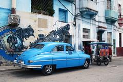 Imposing Blue (emerge13) Tags: cuba centrohabanacuba havana habana havane streetlife streetart callejóndehamel classiccars cubacars cayohuesocentrohabana blue travel voyages voituresclassiques murales urbanart