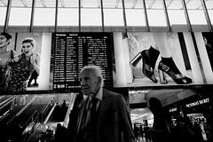 DSCF8286 (Marco Ascrizzi) Tags: fuji x70 bw street train station termini old man commercials armani victoria secrets secret roma rome italy