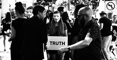 Truth (jgottlieb) Tags: seattle downtown westlake center wa washington truth protesters left turn sign street photography man walking people talking masked woman holding leica mp typ 240 35mm summilux fle