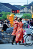 Togetherness (Roving I) Tags: brideandgroom bridalcouples brides grooms costumes tradition walking instep hoian embrace tourists evening sunset vietnam vertical