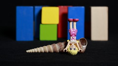 Stephanie standing on her head at the beach (MuTant 99) Tags: home toy lego miniature stephanie seashells wooden blocks