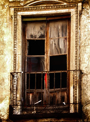 Window in Toledo (Tiigra) Tags: toledo castillalamancha spain es 2003 architdetail balcony glass lattice ruin town window wood pattern