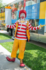 Ronald McDonald in front of the Ronald McDonald Care Mobile™ (UTHealth) Tags: ronald mcdonald care mobile uthealth school dentistry houston texas children health dental