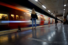 Woman waits at St James Park (Luke Agbaimoni (last rounds)) Tags: lighttrails light perspective train ghost longshutter londonunderground london londontube