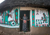 Ethiopian woman standing in front of her traditional painted house, Kembata, Alaba Kuito, Ethiopia (Eric Lafforgue) Tags: abyssinia adult africa alaba architecture art building buildingexterior circular color culture decorated decoration depiction eastafrica ethiopia ethnic geometric halaba home horizontal hornofafrica house hut illustration kulito mural naive oneperson onewomanonly outdoors painted painting poverty residential round ruralscene straw thatch thatched toukoul traditional tukul village woman women ethio163497 alabakuito kembata