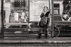 waiting for the tram (Gerard Koopen) Tags: nederland netherlands amsterdam city capital hoofdstad woman waiting tram horse smoking candid straat street straatfotografie streetphotography bw blackandwhite fuji fujifilm xpro2 56mm 2017 gerardkoopen