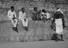 Men smoking ganja along the Ganges Varanasi India (BooBoopdx) Tags: nikon d7100 afs dx 1685mm f 3556 nikkor india varanasi ganges marijuana ganja banares men smoking sitting talking brick wall morning sunrise black white photography street casual candid assi ghat