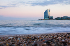 Down by the Sea, Barceloneta (Geraint Rowland Photography) Tags: barceloneta barcelona spain barcelonabeach beach ocean playa seaside downbythesea wwwgeraintrowlandcouk visitbarcelona shingle sand sea med geraintrowlandphotography nature sunset settingsun longexposure waves water love peace catalonia