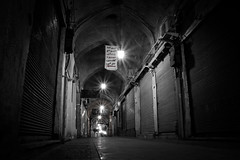 after hours (freakingrabbit) Tags: city street light old urban architecture shadow black white monochrome empty dark abandoned alley tube iran bazaar yazd persia perspecitve no person