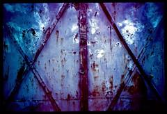The Gate (Moryc Welt) Tags: slides transparency reversal kodake100g lomo lca iscanforlinux gimp tetenalsp45 epsonv600 lightleak metal gate lomography texture diy homemadesoup