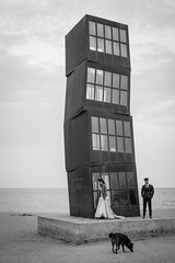 Down by the Sea, Barceloneta (Geraint Rowland Photography) Tags: visitbarcelona barceloneta barcelona catalonia spain europe blackandwhite beachphotography streetphotography candidportraits models modelphotography weddingphotography lifeinbarcelona streetdog loveandromance spanishculture canon 50mm geraintrowlandphotography wwwgeraintrowlandphotography sand clouds sunset tower modernart gaudi artonthebeach beachart