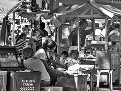 Busy Corner (Beegee49) Tags: street stalls black whit vendors busy silay city philippines