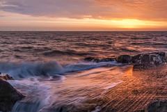 Golden moments... (Einir Wyn Leigh) Tags: sunrise golden beach shore home waves sea coast wales yellow sunlight shadows camera lens darkness morning beauty sun light fun bay cymru sand summer sunshine uk britain