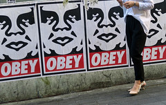 Obey (Mondmann) Tags: obey posters streetart street streetphotography itaewon seoul korea woman legs pedestrian posterart art southkorea rok republicofkorea asia eastasia mondmann canonpowershotg7x