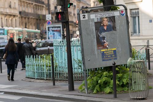 Marine Le Pen, torn campaign poster, Paris
