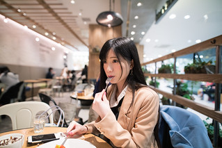 Young woman taking coffee break at open cafe