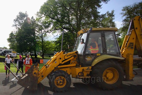 A JCB passes Will Burns' grid spot at Oulton Park, May 2017