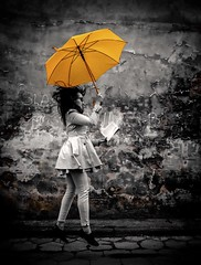 Girl With an Umbrella (karolklaczynski) Tags: fujifilm xt1 girl umbrella yellow street obscure flying levitate levitating book shining selective color saturation wroclaw poland reading