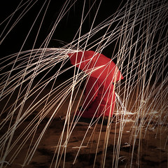 Fire Rain (Rand0mmehere) Tags: linnea albrechtsson rand0mmehere art artsy abstract attitude square woman wonderful expression red rain yellow mysterious lines umbrella uncover under fire inspired outside people silhouette dark darkness fantasy girl human ljus key low light lights lightpainting exposure relaxed creative color contrast wool steelwool stålull steel motive stealwool