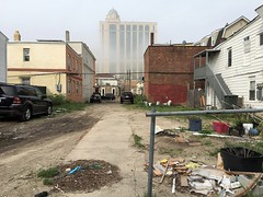Backyards, Atlantic City_jpg (ted cavanagh) Tags: atlanticcity fog houses backyards trash parkedcars urbanblight casinos