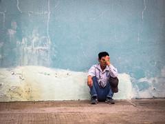 A Long Day on Cheung Chau (Feldore) Tags: cheung chau hong kong street candid hongkong tired weary man wall painted colourful island feldore mchugh em1 olympus 1240mm sitting haunches crouched