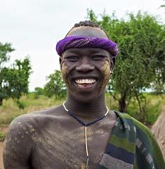 Happy Mursi Warrior (Rod Waddington) Tags: africa african afrique afrika äthiopien ethiopia ethiopian ethnic etiopia ethnicity ethiopie etiopian endangered omo omovalley outdoor portrait people painted warrior mursi tribal tribe traditional village mago smile happy