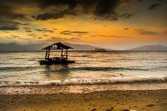 Solitary Floater (neilsinadjan) Tags: barge floater sun sea beach masasa tingloy batangasmphilippines sunset sky waters ocean