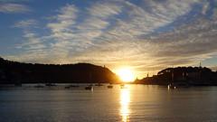 Fan Clouds and Harbour Lights (Mark BJ) Tags: majorca spain portdesóller harbour yachts sunset reflection clouds mallorca village horseshoeharbour sandybeach beach headland lighthouse lighthouses espana