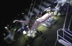 The Art of Flight (Ca$hreno) Tags: film natura1600 carnival free fly yashica yashicat4 grainy nightphotography blur carlzeiss her fun cashreno pointandshoot flight tessar girlsonfilm 1600iso hawaii freedom filmphotography swings wings